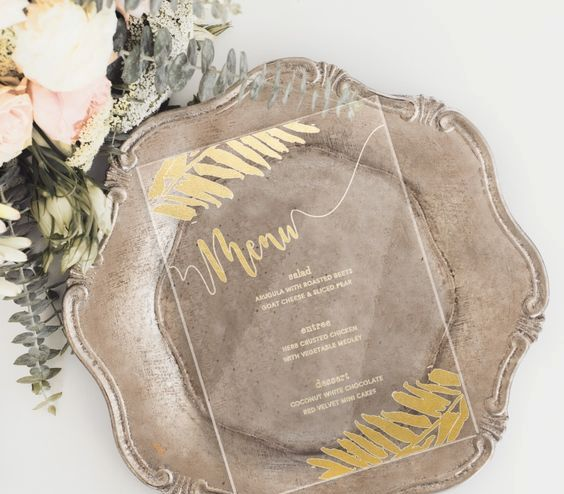 acrylic wedding menu with gold decor for a refined tablescape