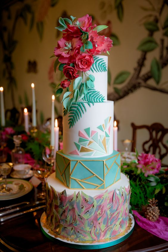 bold spectacular wedding cake with geometric decor and edible flowers
