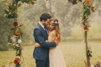 21 branch wedding arch with leaves and bold flowers for a fall wedding