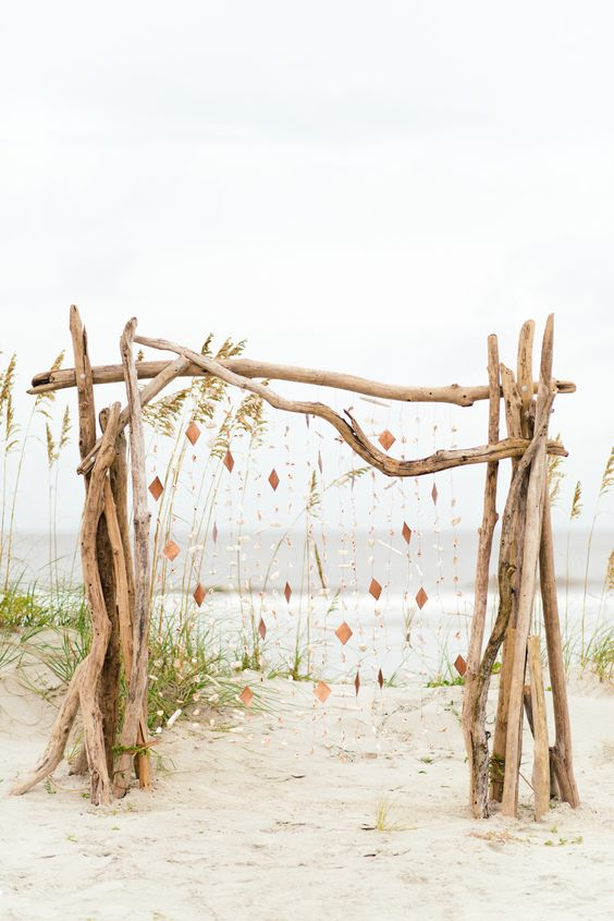 driftwood wedding arch with hangings for a boho beach wedding