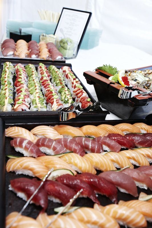 fresh sushi selection on black metal stands
