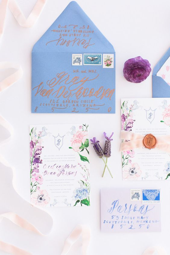 lavender-inspired wedding invitations with a blue envelope and calligraphy