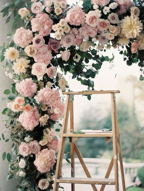 lush pink and ivory floral wedding arch is a perfect choice for a summer garden wedding
