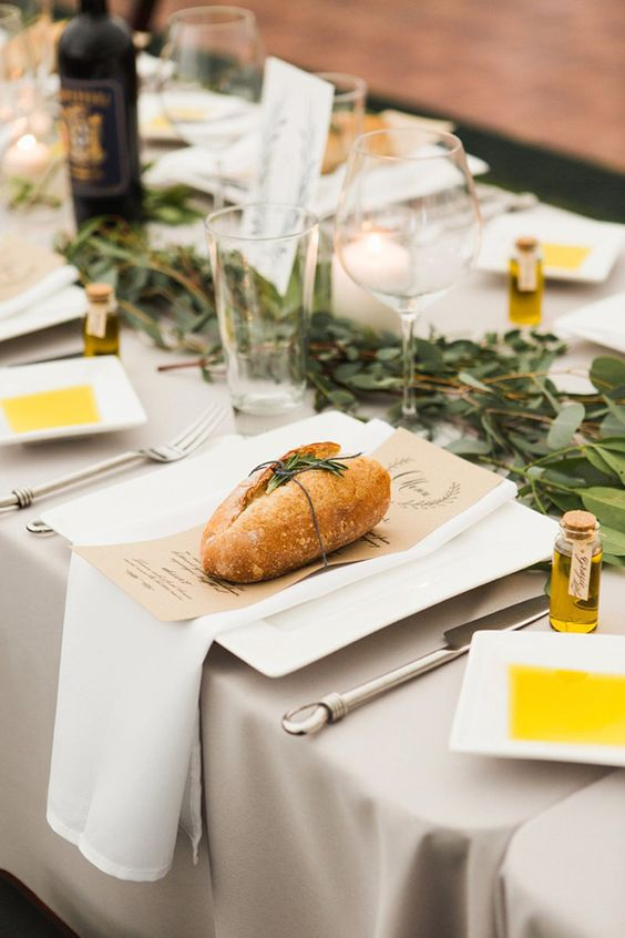 traditional Italian bread and olive branches to decorate a wedding table
