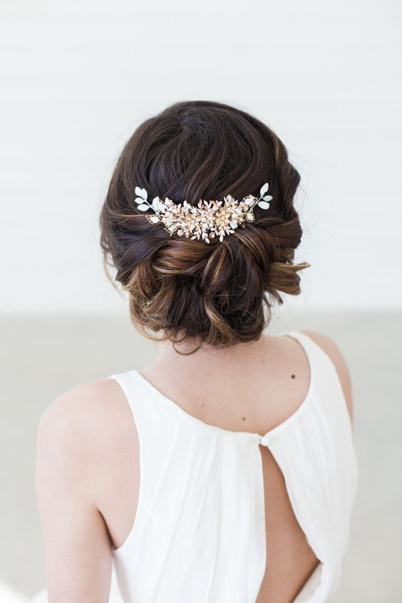 braided updo with a beautiful hair vine of white beads and pearls