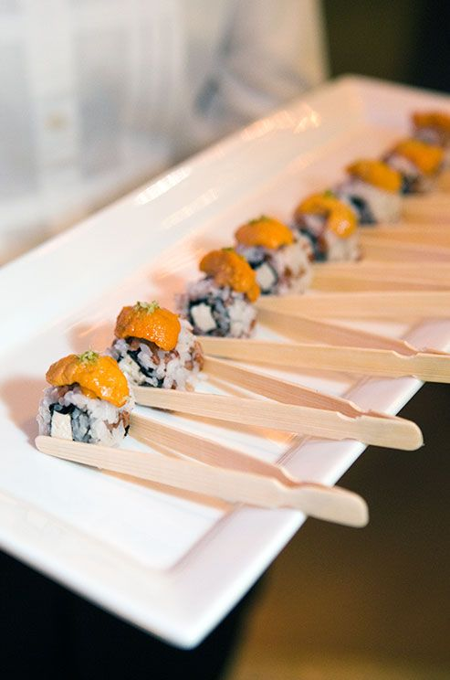 individual sushi rolls in wooden holders
