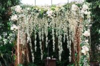 22 lush greenery and flower wedding arch with hanging flowers can easily fit lots of styles