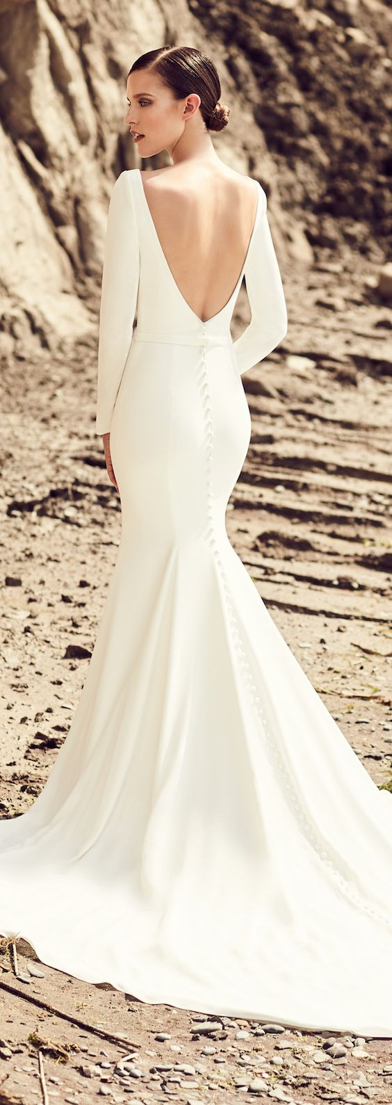 modern plain wedding dress with sleeves, a mermaid silhouette and a V cutout back
