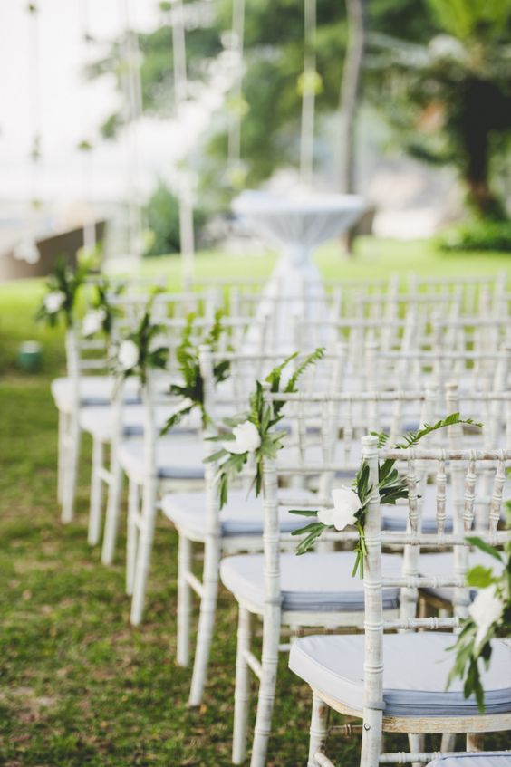 tropical greenery and white flower chair markers