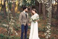 24 boho rough wood wedding arch with greenery and leaves for a fall wedding
