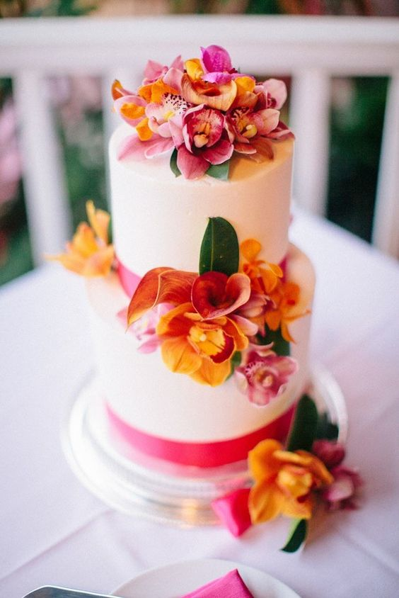 deck out your tropical wedding cake with orchids for a fab floral dessert