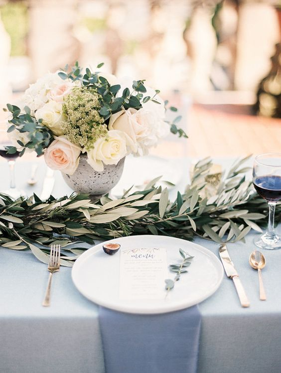 light grey and blue wedding tablescape, neutral florals and olive leaves