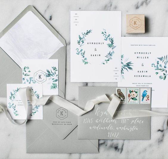 modern elegant invitation suite with greenery and blue flowers