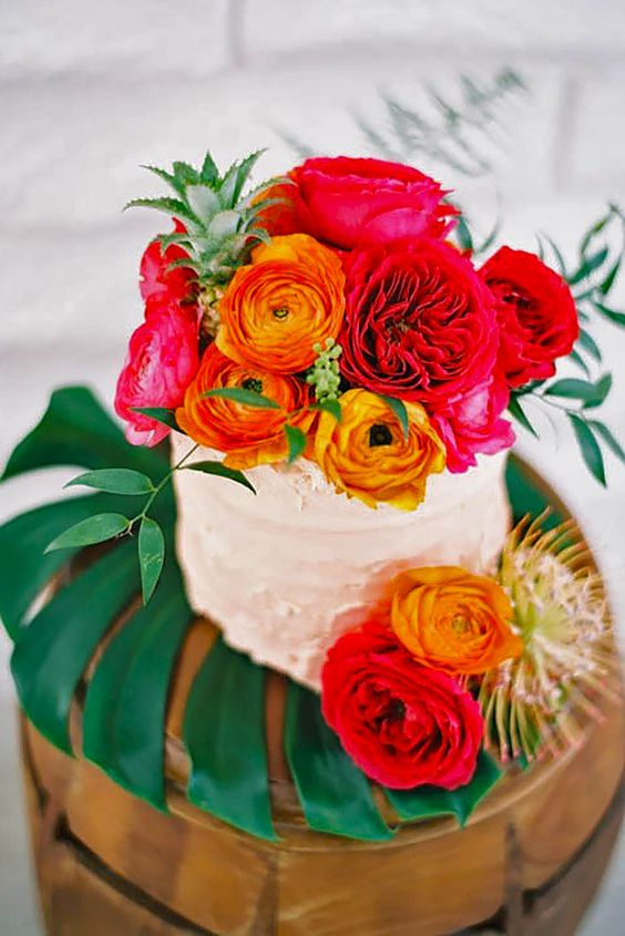 dirty icing wedding cake with bold blooms all over