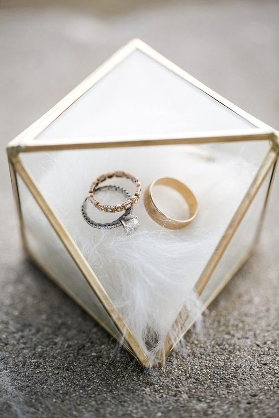 geometric brass and glass box with faux fur inside