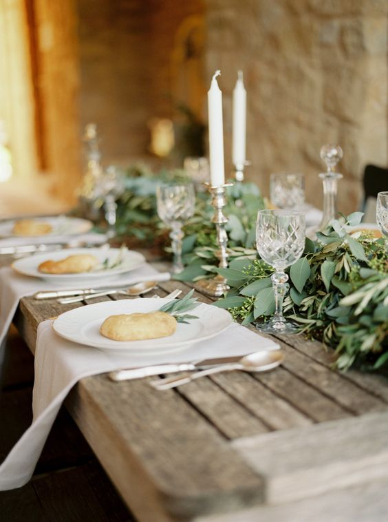 rustic table decor with bread and eucalyptus, candles for a refined look