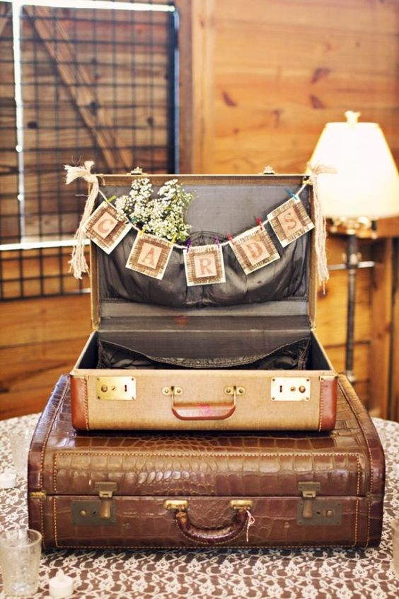 vintage suitcase with a garland and baby's breath