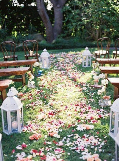 wedding aisle covered with flower petals screams summer and garden