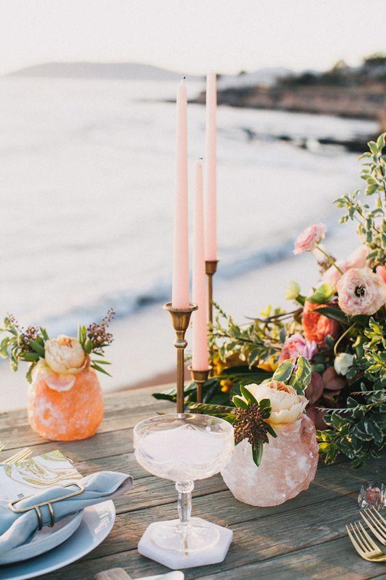 pastel boho beach wedding tablescape with candles and quartz details