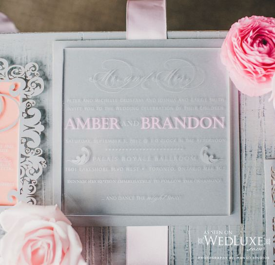 simple acrylic menu with white and pink calligraphy