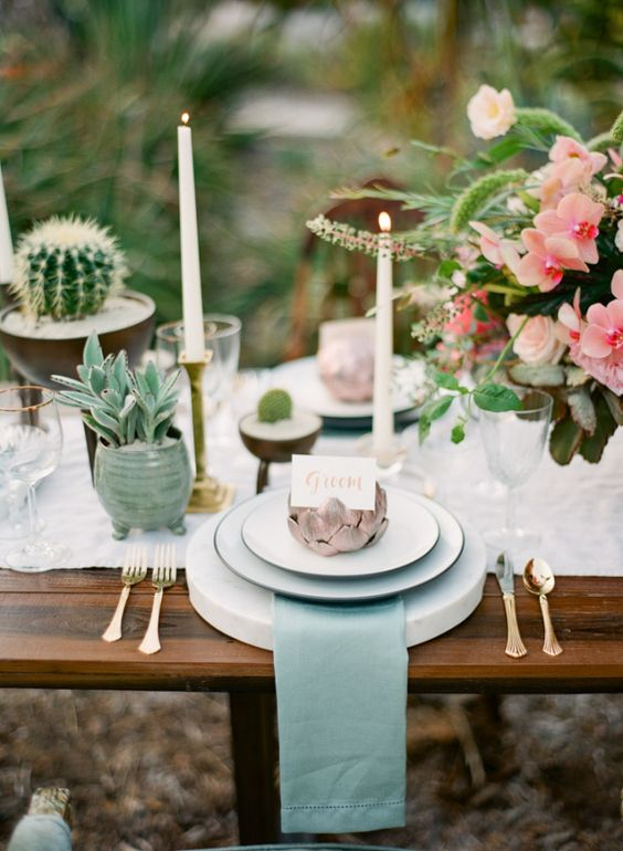 desert boho wedding tablescape with green details and cacti