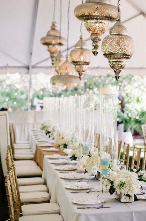 exquisite white table decor and multiple hanging lanterns