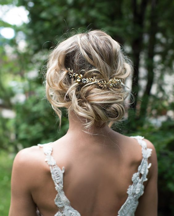 messy twisted updo with a beautiful gold tone hair vine