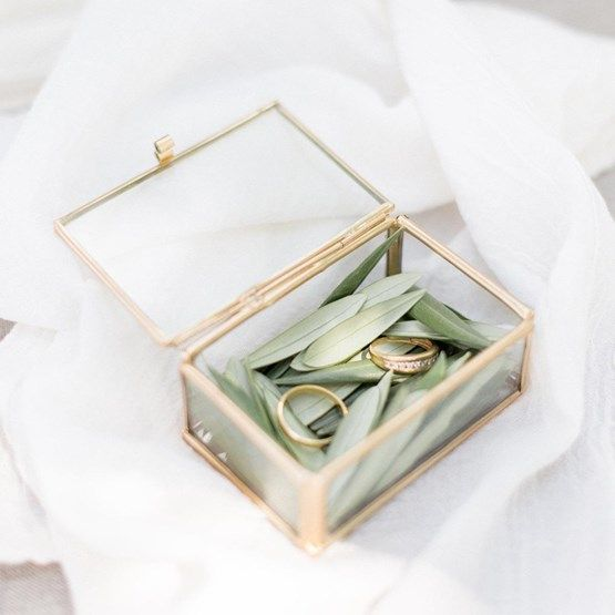 small glass and brass ring box with leaves inside