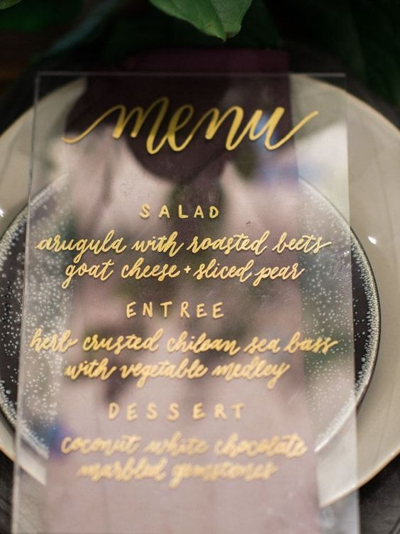 stylish acrylic menu with gold calligraphy