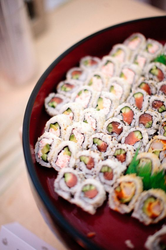 sushi on red and black Asian plates give your food bar a Japanese feel