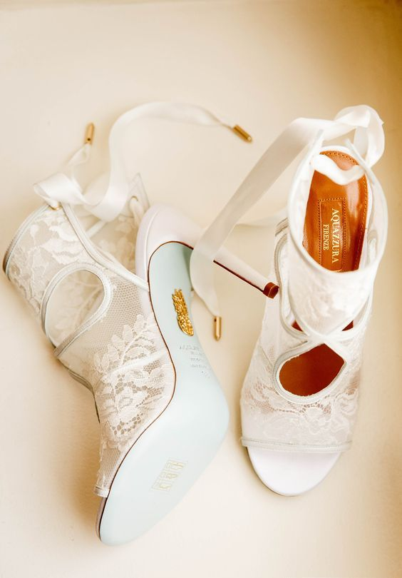 white lace boots with cutouts and peep toes look very trendy