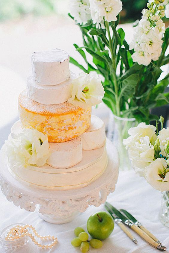 a vintage white display, cheese wheels and white blooms for decor