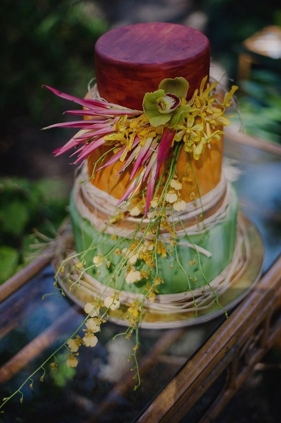 hand painted red, orange and green wedding cake with flowers