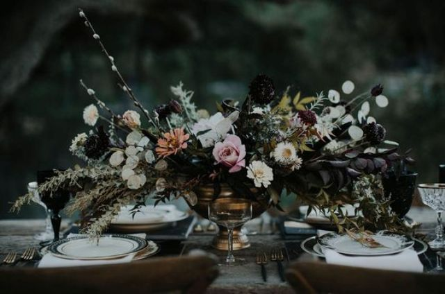vintage haunted wedding table setting with dark florals