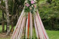 29 bold ribbon teepee with lush flowers on the top