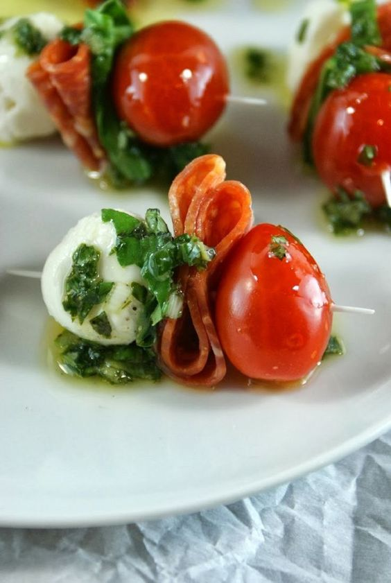mozzarella, prosicutto, tomatoes and greenery for appetizers