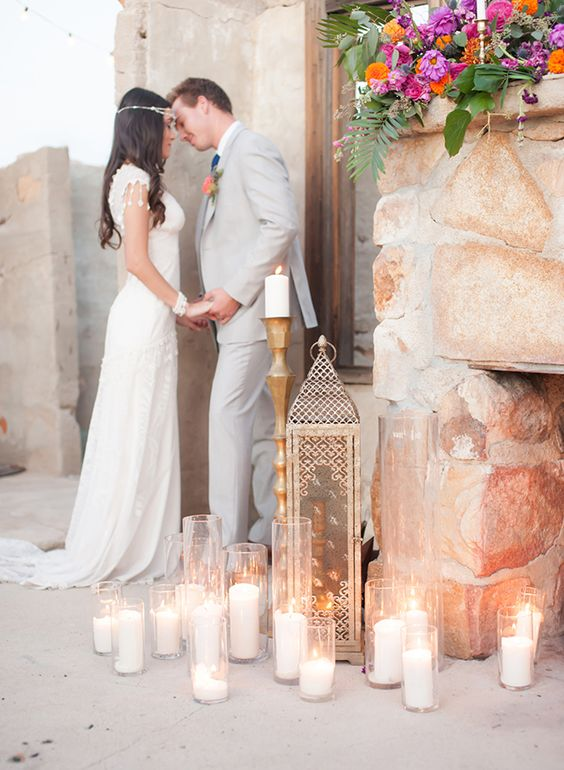 multiple candles and a large lantern for the ceremony space