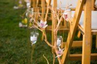 29 pebbles, orchids, candles arrangements for marking the aisle
