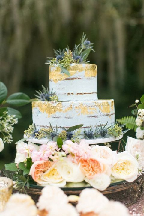 semi naked wedding cake with metallic details and thistle