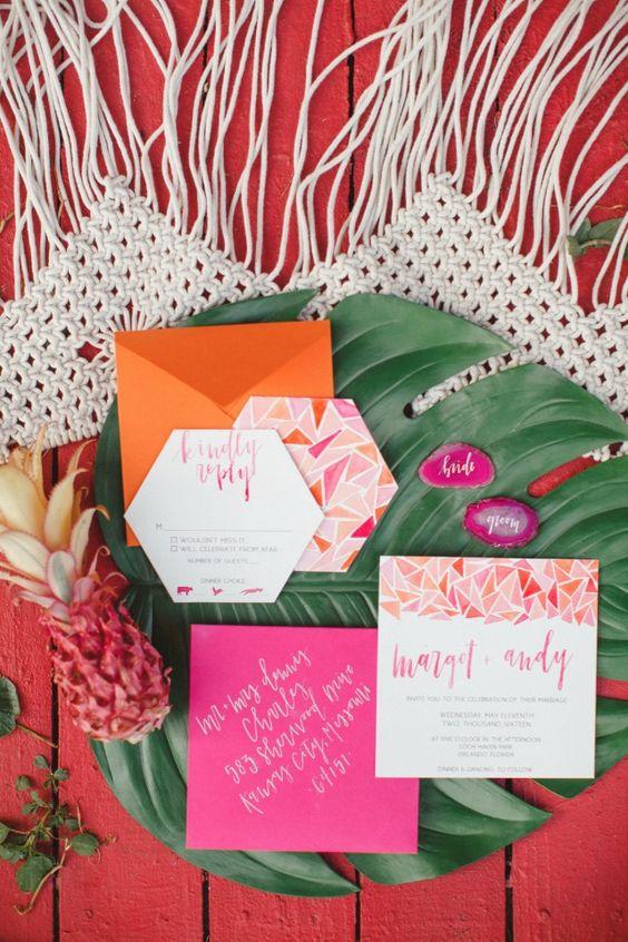 colorful geometric wedding stationary, hot pink and orange envelopes