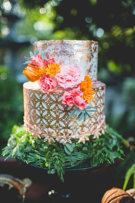 metallic pattern wedding cake with bold flowers