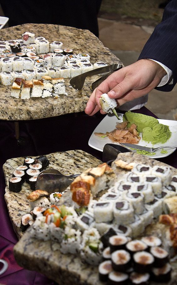 textural boards with various kinds of sushi