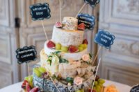 31 cheese tower with grapes, figs and toppers to define each type