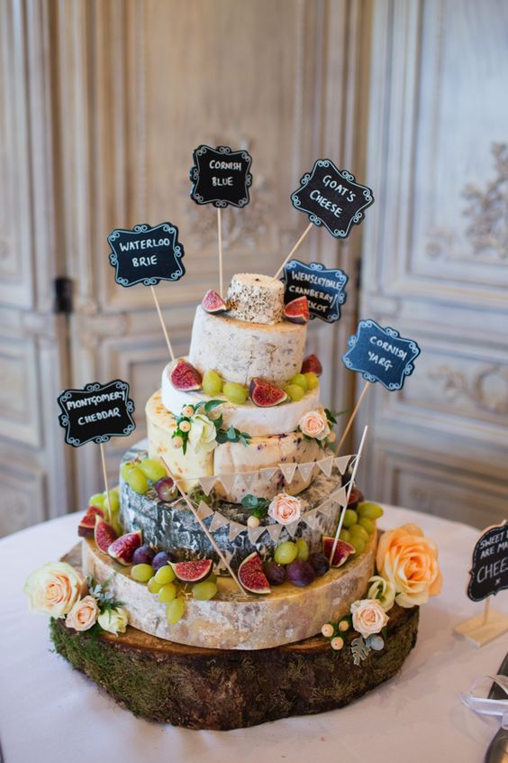 cheese tower with grapes, figs and toppers to define each type
