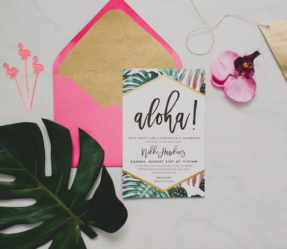 colorful invite and a pink envelope with neutral lining