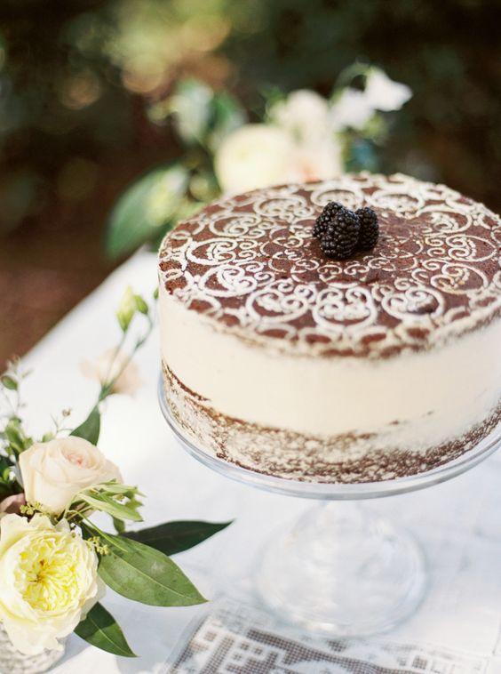 tiramisu wedding cake topped with berries