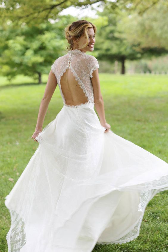 triangle cutout back wedding dress, cap sleeves and a long, full skirt