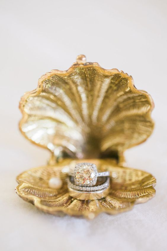 a gilded sea shell as a wedding ring box
