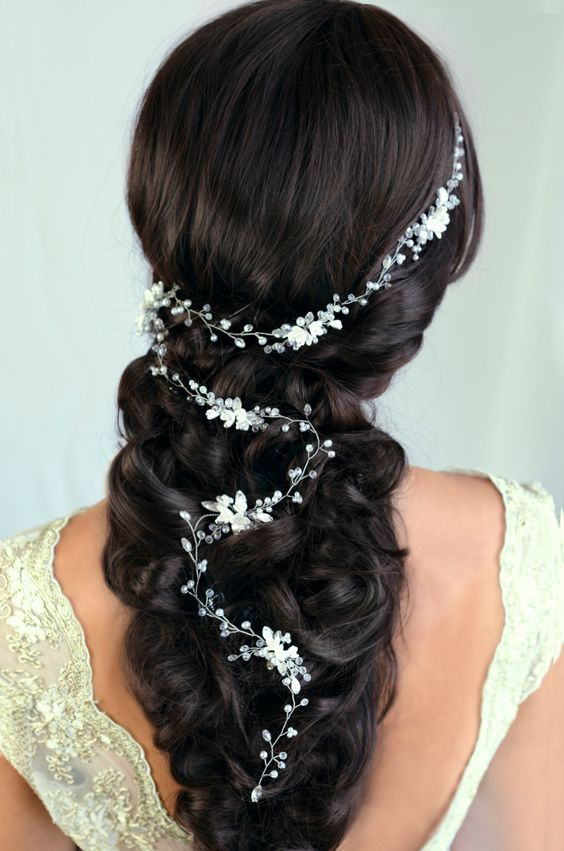 boho braided hairstyle with a long pearls and crystals hair vine