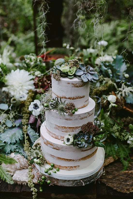 naked wedding cake with succulents, thistles and leaves